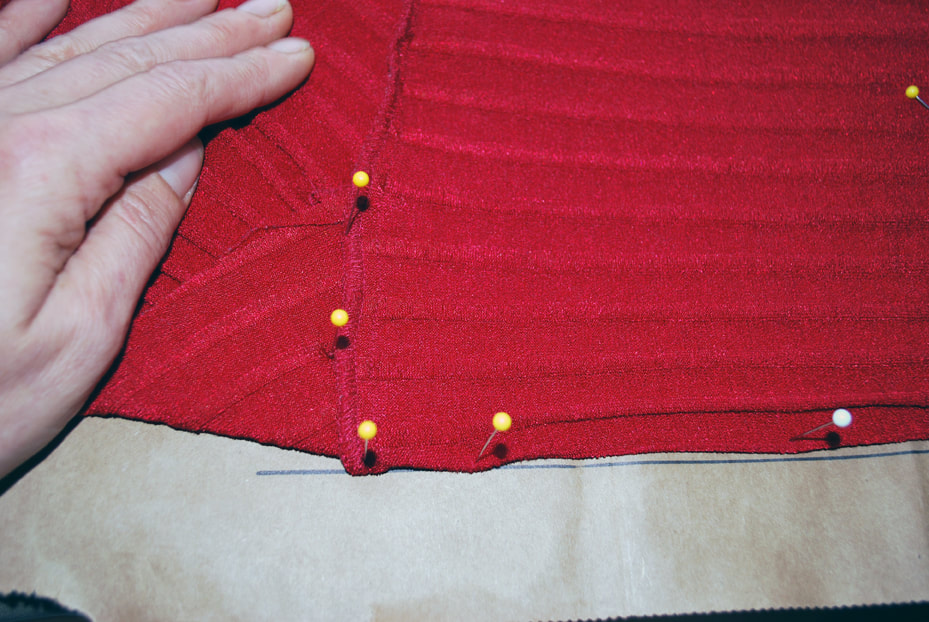 Pinning along the under bust seam line of the top, making sure to put pins to mark where the bust pieces overlap above the tummy panel.