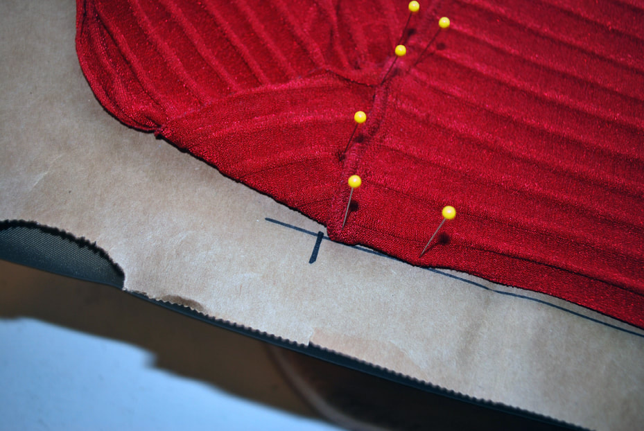 Drawing a cross hatch at the top of the tummy panel, right where the seam line starts.