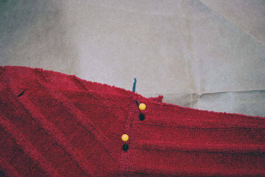 Drawing a cross mark where the under bust seam meets the side seam.